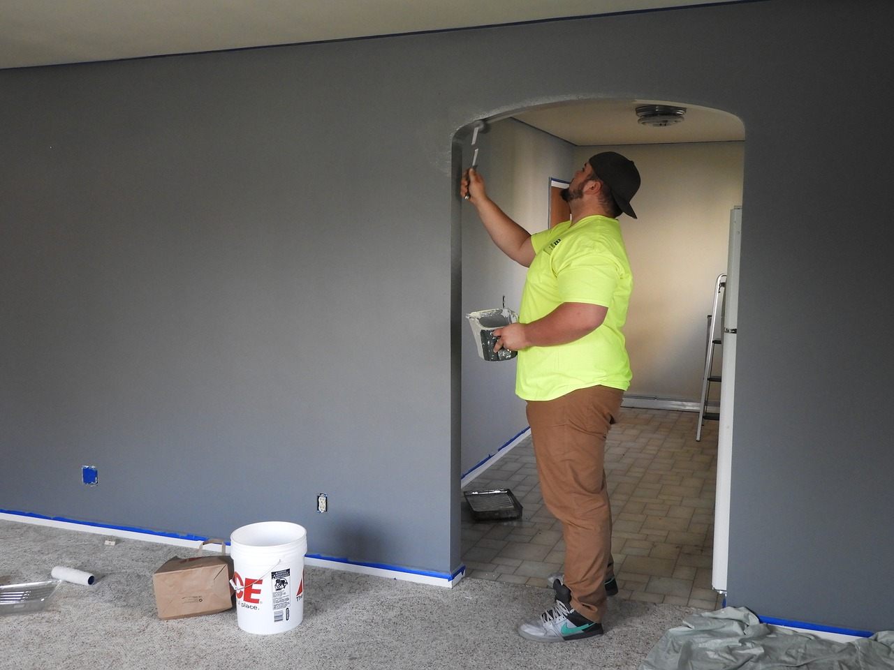 Residential drywall contractor painting a home