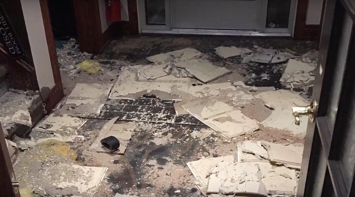 restoration services observing cracked tiled floors
