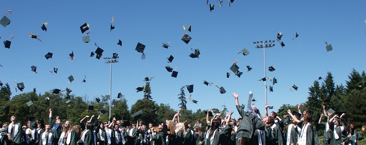 high school graduation ceremony filled with future drywall contractors